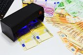 Money Fake Testing - Euro Banknotes Authentication Check In Uv Currency Detector Lights. Counterfeit poster