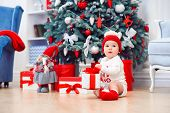 Charming Toddler Boy Holds Christmas Gift Box. Concept Of Christmas Holidays. poster