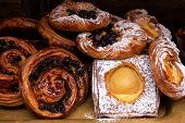 Freshly Baked Danish Pastries, Custard, Apricots, Raisins, Cinnamon Swirl Dusted In Icing Sugar And  poster