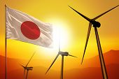 Japan Wind Energy, Alternative Energy Environment Concept With Turbines And Flag On Sunset - Alterna poster
