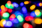 Abstract Festive Background Of  Blurry Garland Lights. Backdrop With Blurry Colored Lights For New Y poster