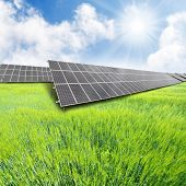 stock photo of ethanol  - Solar energy panels on a green wheat field - JPG