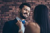 Closeup Photo Of Two Affectionate People Couple Guy Looking Eyes Lady Who Fixing Blue Stylish Bow Ti poster