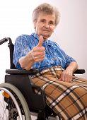 foto of elderly woman  - elderly woman in wheelchair giving the thumb - JPG