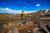A Single Man Looking At Landmannalaugar Valley From The Top. Iceland Travel Background. Success Achi poster