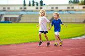 Child Running In Stadium. Kids Run. Healthy Sport. poster