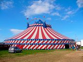 foto of circus tent  - Circus big top tent in field decorated with stars and stripes - JPG