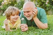 Portrait Of Happy Senior Man Father Smiling And Happy Cute Son. Father And Grandfather. Happy Family poster
