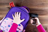Girl Hides A Gun In A School Backpack. Covert Carrying Weapons For Protection. Weapons At School, As poster