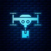 Glowing Neon Delivery Drone With The Package Icon Isolated On Brick Wall Background. Drone Deliverin poster