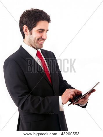 Handsome smiling business man holding a digital tablet, isolated on white