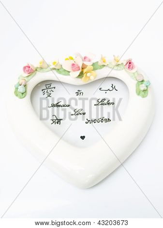 A White Ceramic Hearth With Various Language Meaning Of Love Isolated On White Background
