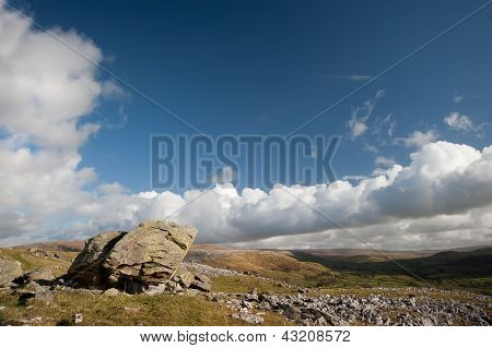 Norber Erratics With Moughton Scar And Wharfe Dale In Background In Yorkshire Dales National Park
