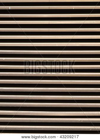 Brown Metal Vertical Fins As Background