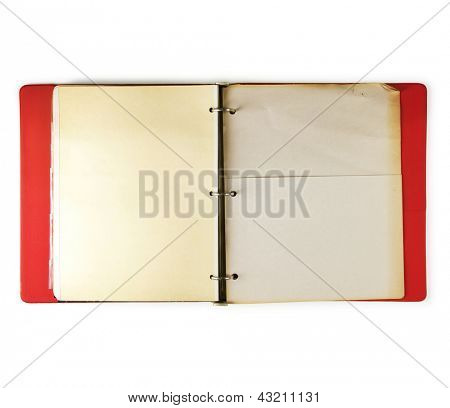 Old three ring red binder open, with old paper pocket page, isolated on white.