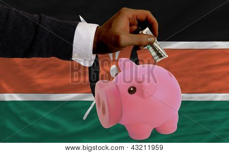 Dollar Into Piggy Rich Bank And  National Flag Of Kenya