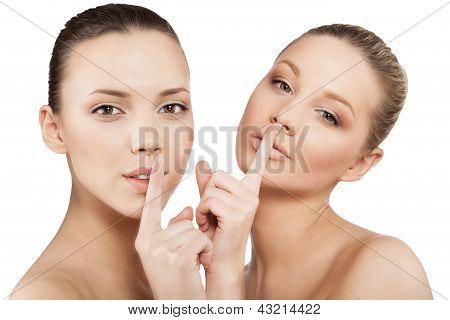 Women Making A Hush Gesture