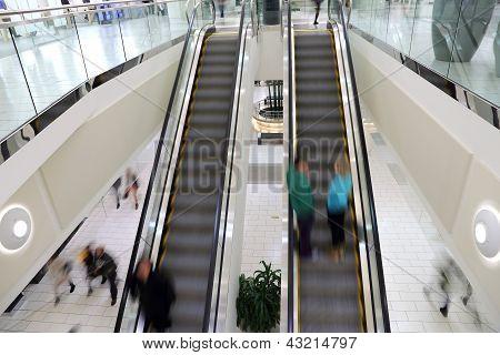 People in motion in escalator