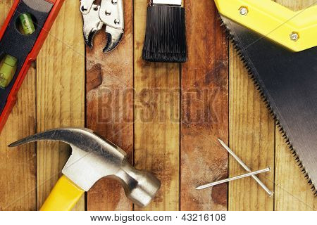 Assorted work tools on planks of wood