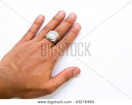 A Guy Hand With White Jade Ring On His Finger Isolated On White Background