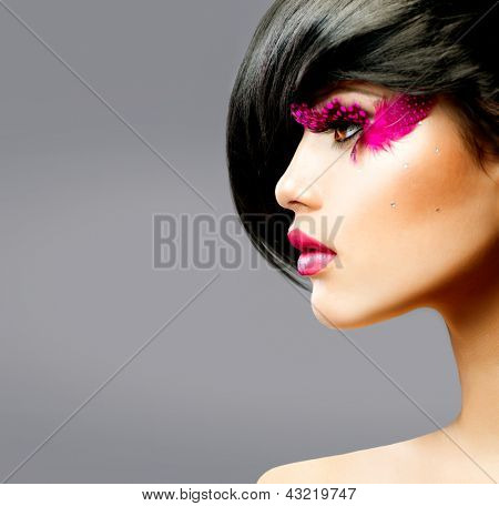 Fashion Brunette Model Profile Portrait. Hairstyle. Haircut. Hairdressing. Professional Makeup. False Feather Eyelashes. Fashion Art. Vogue Style