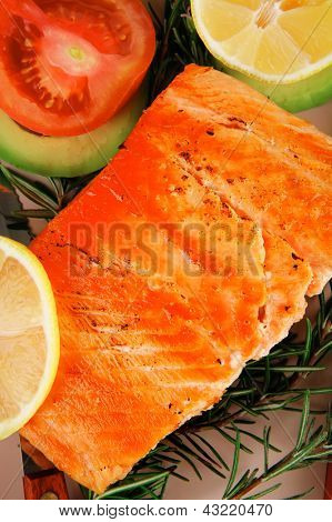 healthy food: hot baked salmon piece served over glass plate isolated on white background