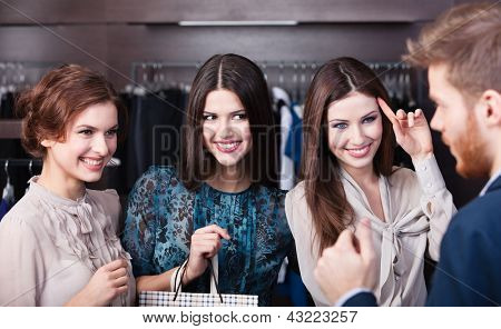 Three wonderful women flirt with salesperson