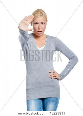 Girl making stop gesture with her palm, isolated on white