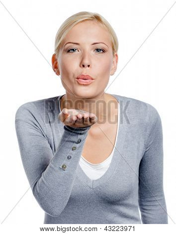 Woman kisses her hand to somebody whom she loves, isolated on white