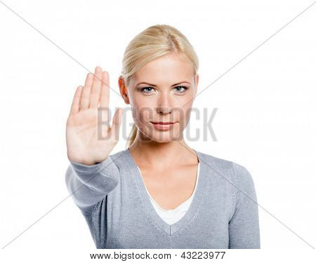 Lady making stop gesture with her palm, isolated on white