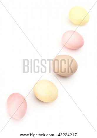 Semicircle of multicolored hen's eggs, isolated on white