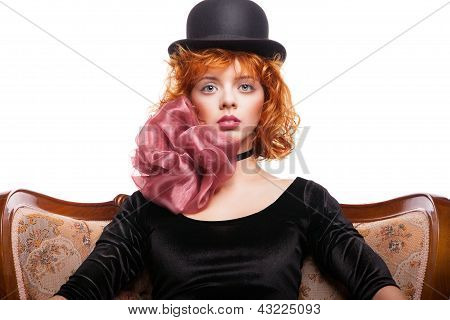 Girl with red hair, pink bow over white