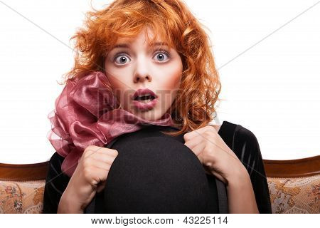 Surprised girl with red hair, pink bow over white