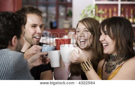 Young Friends Toasting With Coffee Cups