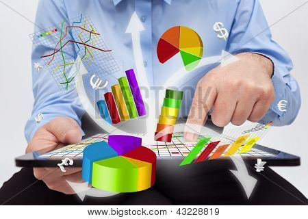 Businessman Working On Tablet Computer - Producing Charts