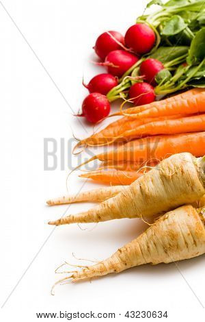 root vegetables on white background