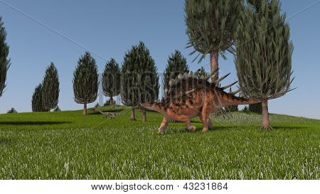 kentrosaurus in green grass field