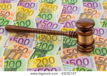 gavel and euro banknotes. symbol photo for costs in court of law and auctions