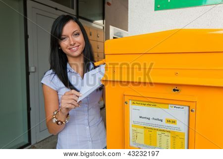 young woman with a voting card (austria)