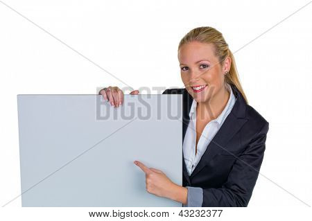 a young pretty woman in business clothing with a blank billboard.