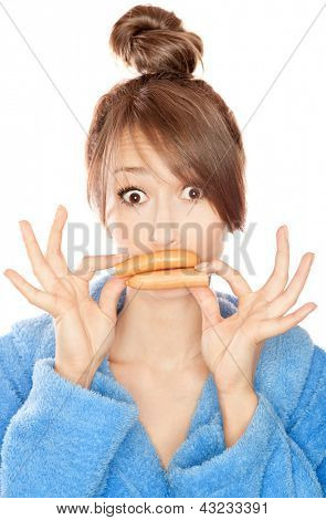 Woman with sausages simulating lip enhancement she's dreaming of filler injection
