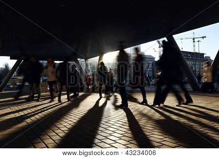 People walking near the metro station.