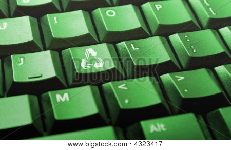 Green Computer Keyboard With Recycle Logo