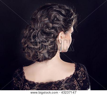 Hair. Wavy Hairstyle. Beautiful Brunette Girl. Curly Hair.