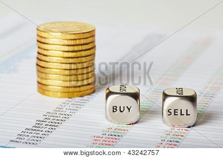 Financial Charts, Coins And Dice Cubes With Words Sell Buy. Selective Focus