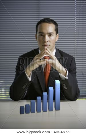 Business Man With A 3D Growth Chart