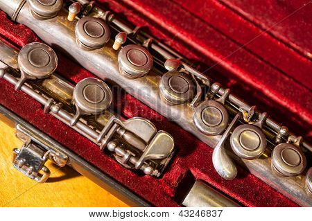 Close-up Of Vintage Brass Flute In Red Velvet Case