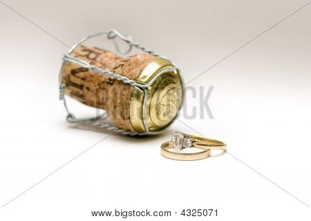 Wedding Rings And Champagne Cork
