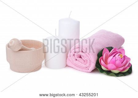 Pink Flower And Towel With Two Candles. Spa Composition