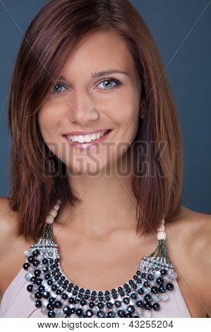 Portrait Of Smiling Brunette Girl